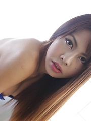 20 year old busty Thai ladyboy strips to her big boobs and cock