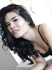 23 year old horny Thai ladyboy with raven hair andfake boobs striptease